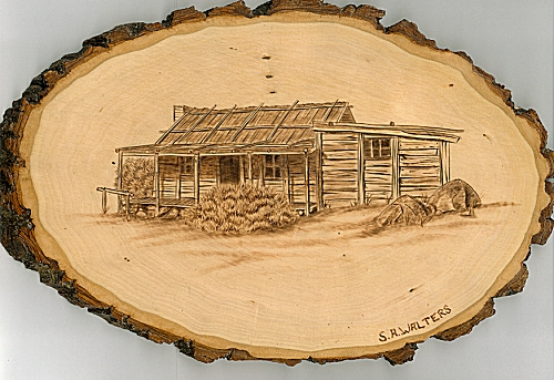 pyrographed picture of the hut by Sue Walters